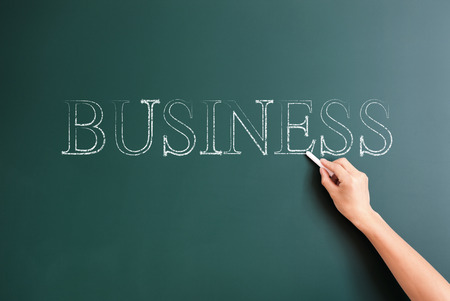 title hands: writing business on blackboard Stock Photo