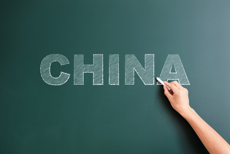 title hands: china written on blackboard Stock Photo
