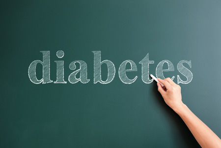 title hands: diabetes written on blackboard Stock Photo