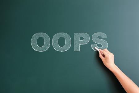 suprise: oops written on blackboard Stock Photo