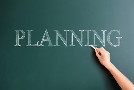 planning written on blackboard
