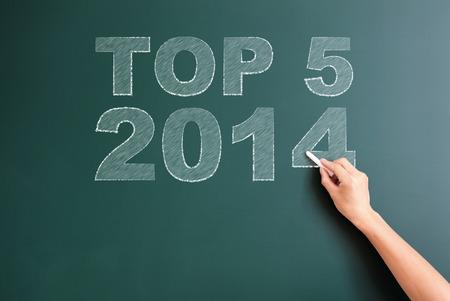 title hands: top5 2014 written on blackboard Stock Photo