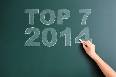 top seven: top 7 2014 written on blackboard Stock Photo