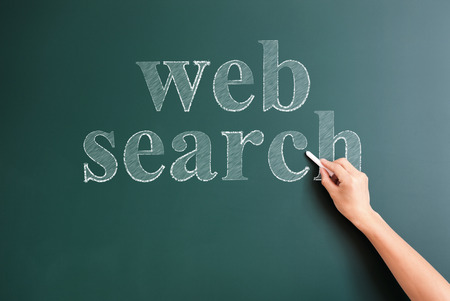 title hands: web search written on blackboard Stock Photo