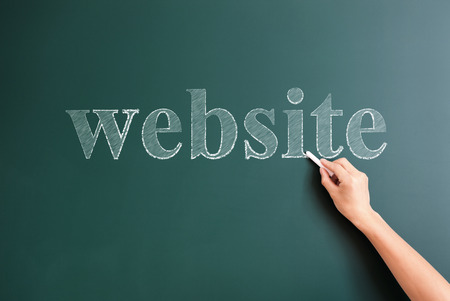title hands: website written on blackboard