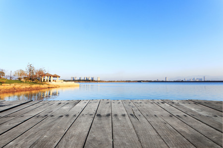suburb: skyline and lake with plank board  near resort in suburb. Stock Photo