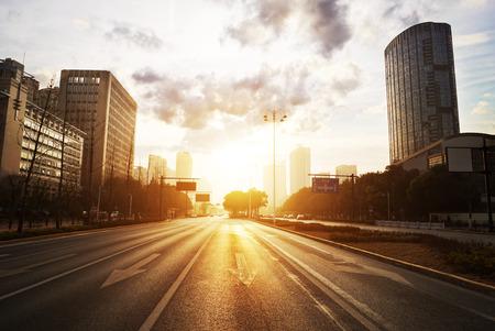 modern city road scene at sunset photo