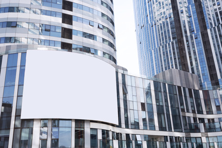 office building exterior: Empty billboard on futuristic office building exterior