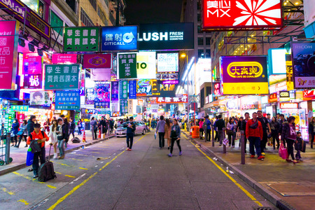 people travel in shopping street of Hong Kong.