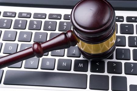 criminal lawyer: judge hammer on keyboard Stock Photo