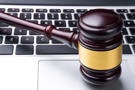 information technology law: judge hammer on keyboard Stock Photo