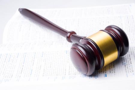 defendant: judge hammer lay on book