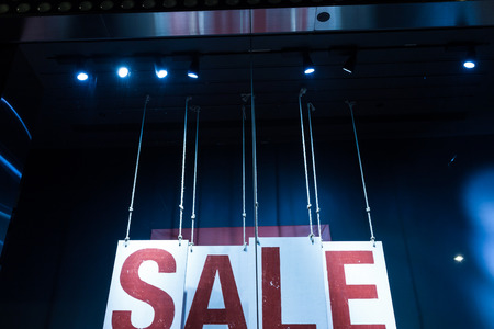 shop window: sale poster in fashion shop display window