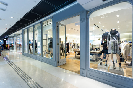 window display: fashion shop display window and clothes. Editorial