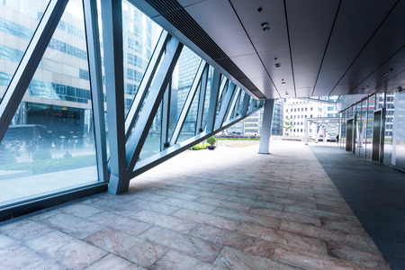 exterior: Empty pavement inside of office building