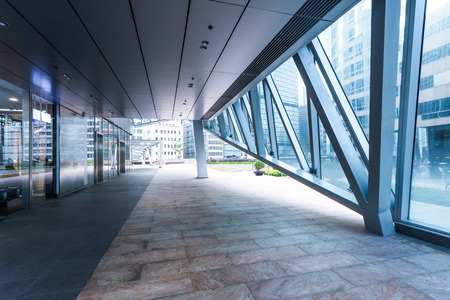 exterior walls: Empty pavement inside of office building