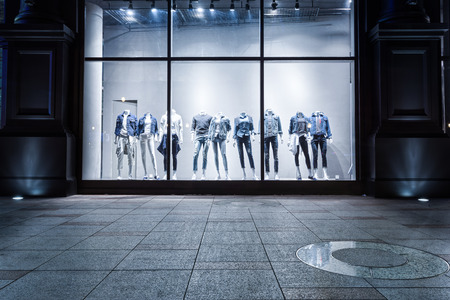 show window: fashion shop display window and clothes. Stock Photo