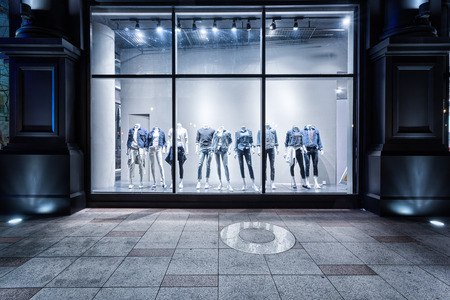 store display: fashion shop display window and clothes. Stock Photo