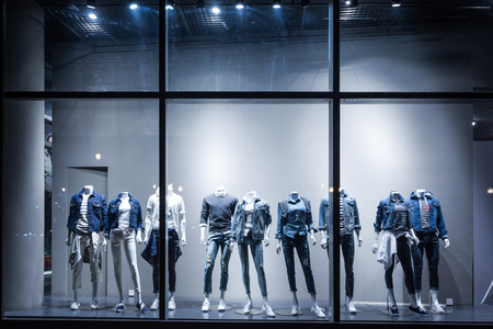 apparel: fashion shop display window and clothes. Stock Photo
