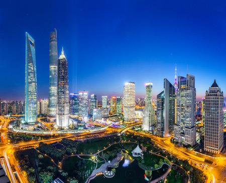 skyscraper skyscrapers: skyline,illuminated skyscrapers in modern city at night. Editorial