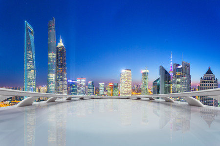 futuristic interior: modern city skyline,illuminated skyscraper looking from futuristic office building interior Editorial