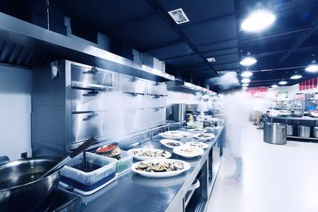 modern kitchen and chefs in restaurant Editorial