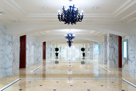 entrances: luxury hotel corridor interior with elegant decorations.