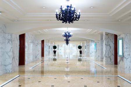 shiny floor: luxury hotel corridor interior with elegant decorations.