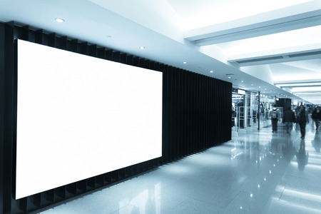 store display: billboard in shopping mall corridor
