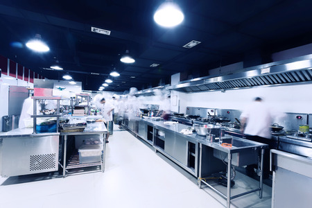 food supply: modern hotel kitchen and busy chefs.