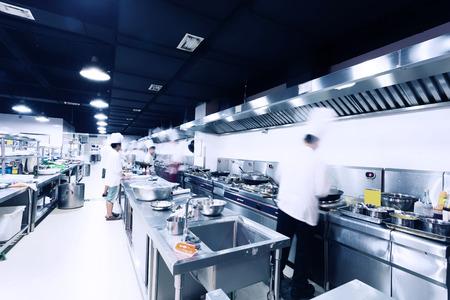 hotel kitchen: modern hotel kitchen and busy chefs.