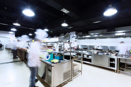 busy restaurant: modern kitchen and busy chefs