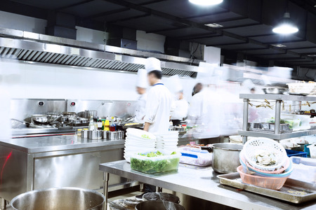 a kitchen: modern kitchen and busy chefs