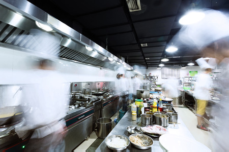 preparing food: modern kitchen and busy chefs