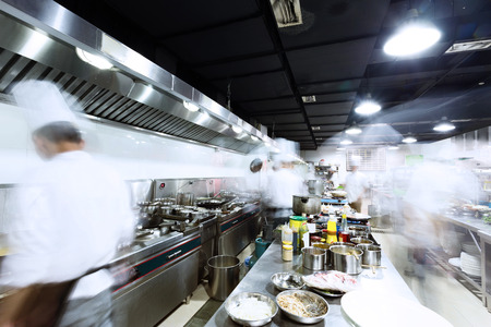modern kitchen and busy chefs photo
