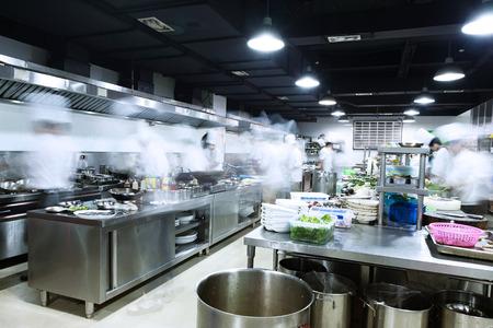 hotel staff: modern kitchen and busy chefs