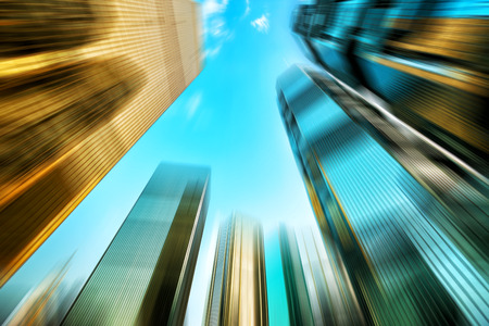exterior wall: low angle view of skyscrapers in blurred motion.