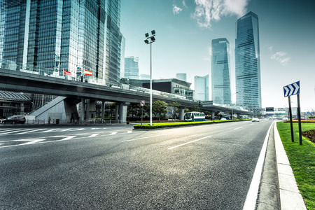 road travel: urban road and modern city skyline Stock Photo