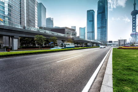 traffic building: urban road and modern city skyline Editorial