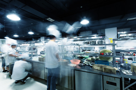 busy restaurant: Modern kitchen and busy chefs in hotel Stock Photo