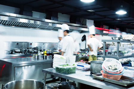 hotel staff: Modern kitchen and busy chefs in hotel Stock Photo