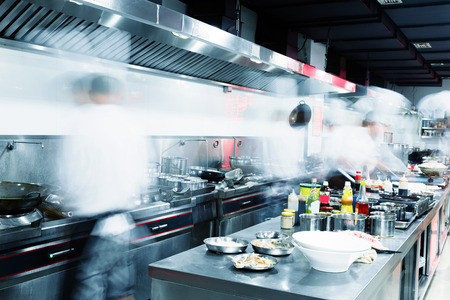 clean kitchen: Modern kitchen and busy chefs in hotel Stock Photo
