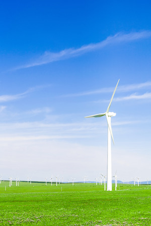 watts: wind turbine and meadow under blue sky Stock Photo