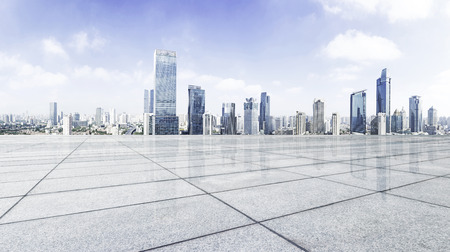 Empty floor with modern skyline and buildings Stock Photo