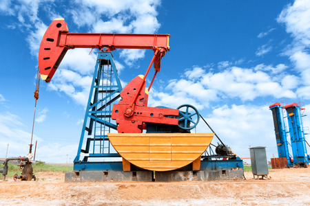 oil barrel: oil well and blue sky Stock Photo