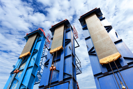 oil and gas industry: oil well and blue sky Stock Photo