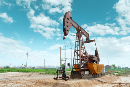 oil tool: oil well and blue sky Stock Photo