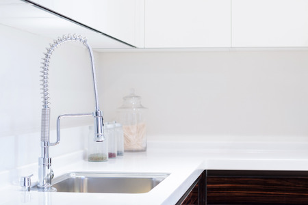 granite kitchen: kitchen sink and decoration Stock Photo