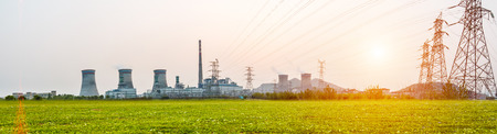 Power station during sunset Imagens