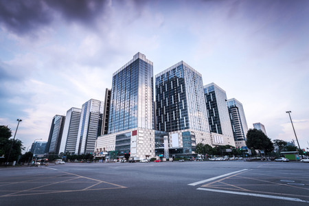 Empty road and modern buildings